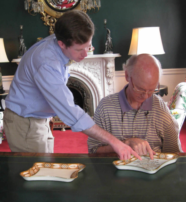 Curator Grant Quertermous of Madison's Home, Montpelier, and  Raleigh DeGeer Amyx, Historian and Collector, examining the two Rarest 1806 serving pieces of James and Dolley Madison