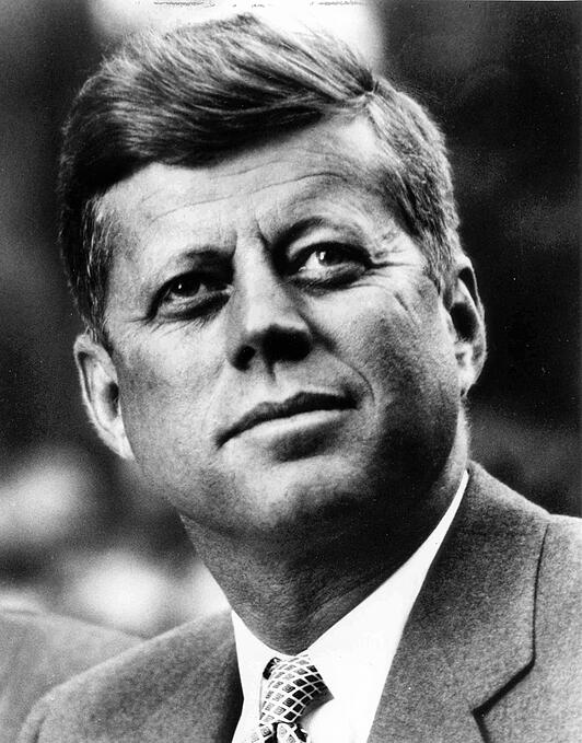 John F Kennedy White House photo portrait looking up