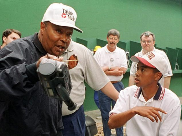 Young Tiger Woods with His Father